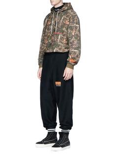 Heron PrestonCamouflage forest print hoodie