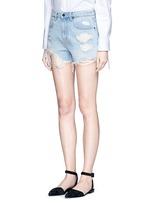 'Bite' distressed cut-off denim shorts