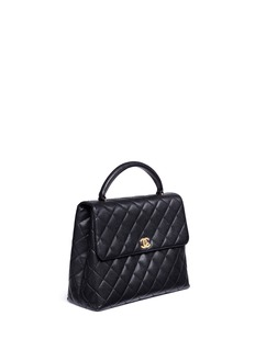 Vintage ChanelKelly caviar leather top handle bag