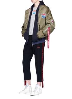 doubletAssorted patch frayed padded bomber jacket