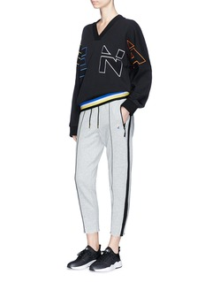 P.E Nation 'Deuce' stripe rib knit outseam track pants