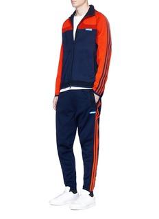 Adidas3-Stripe Tech knit tracksuit