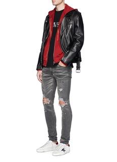 Amiri 'Thrasher' ripped skinny jeans