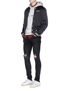 Amiri 'Thrasher' waxed slim fit ripped jeans