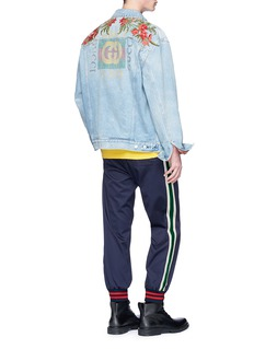 Gucci Slogan floral appliqué oversized denim jacket