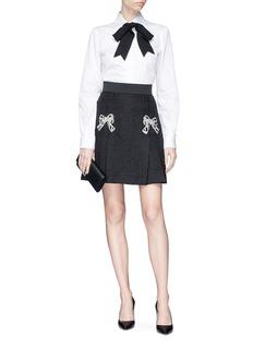 Dolce & Gabbana Bow embellished pleated jacquard flared skirt