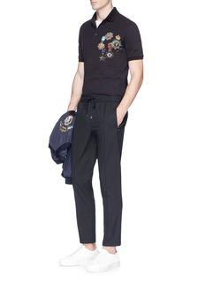 Dolce & GabbanaMedal print polo shirt