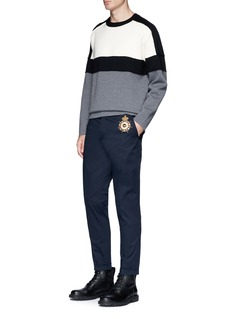 Dolce & Gabbana Crown appliqué twill pants