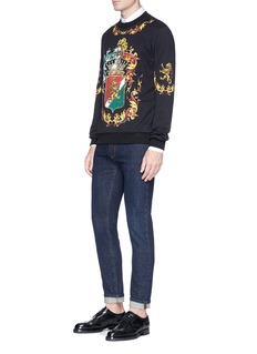 Dolce & Gabbana Crown bee embroidered slim fit raw jeans