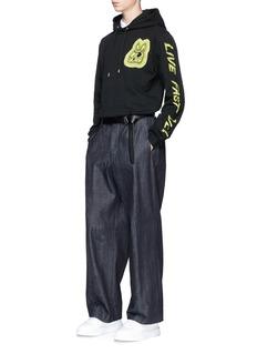 McQ Alexander McQueenSwallow skull appliqué polo shirt