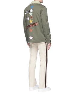 Valentino x Jamie Reid slogan print lambskin shearling collar coat