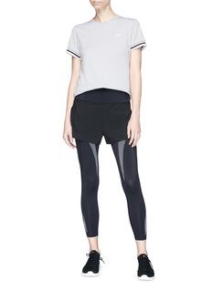 Lndr 'Performance Combo' shorts overlay cropped leggings