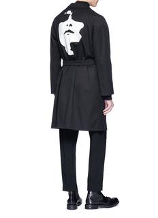 Neil Barrett Abstract face print twill coat