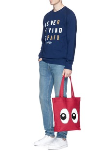 Mostly Heard Rarely Seen 'All Eyes on Me' rubber appliqué tote bag
