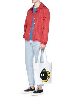 Mostly Heard Rarely Seen'Da Bomb' rubber appliqué tote bag