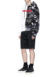 HacullaScribble embroidered camouflage print patchwork hoodie