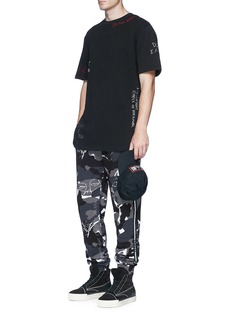Haculla Camouflage print scribble embroidered sweatpants