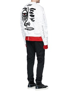 HacullaMotif appliqué scribble embroidered padded bomber jacket