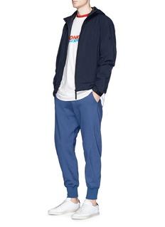 Adidas 'XBYO' reflective print cropped sweatpants
