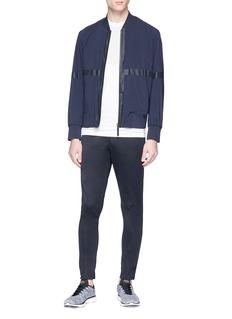 Isaora Reflective trim track pants