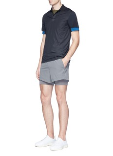 Particle Fever Mesh sleeve performance polo shirt
