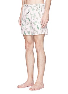 The Upside Cactus print swim shorts