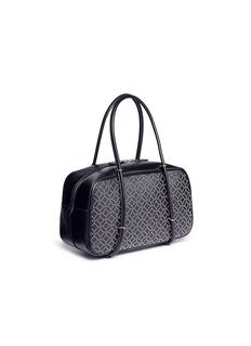 Alaïa 'Clou Arabesque' geometric studded small leather duffle bag