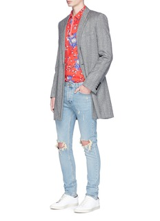 72516Ripped skinny jeans