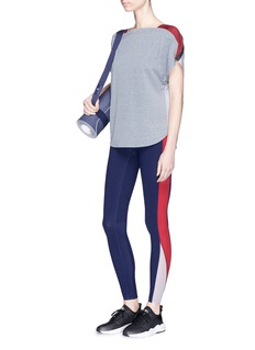Particle Fever x The Woolmark Company snap button shoulder colourblock performance top