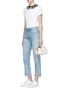 Coach Glitter cherry embossed kisslock glovetanned leather handbag