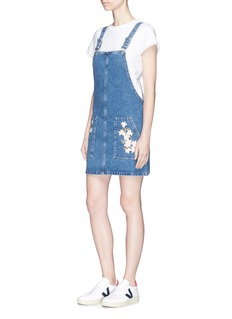Ivy Park 'MOTO' tulip embroidered denim pinafore dress