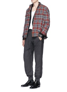 HAIDER ACKERMANN 条纹点缀鱼鳞布休闲裤