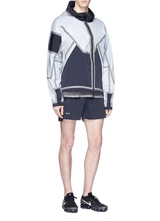 SIKI IM / CROSS Reversible reflective trim colourblock track jacket