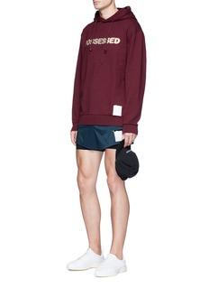 Satisfy 'Possessed' print distressed hoodie