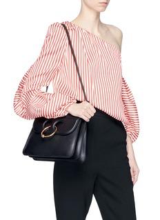 JW Anderson 'Pierce' barbell ring medium leather shoulder bag