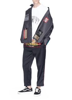 doublet Graphic embroidered track pants