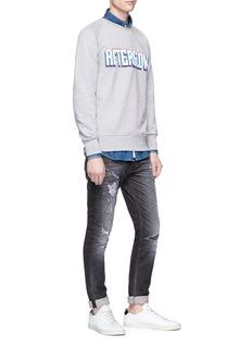 Denham 'Bolt' paint splattered skinny jeans