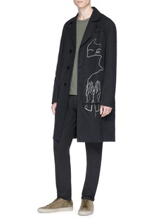 Indice Studio 'Soloist' abstract face embroidered patchwork coat