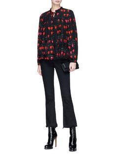 Alexander McQueen Asymmetric ruffle petal print silk blouse