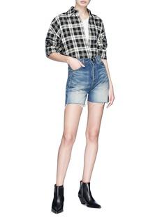 SAINT LAURENT Logo stitched raw edge shorts