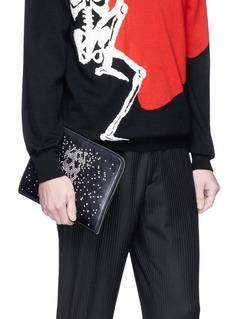Alexander McQueen Skull stud calfskin leather zip pouch