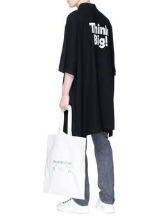 Balenciaga 'Think Big!' slogan print oversized polo shirt