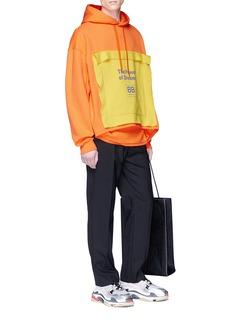 Balenciaga Slogan appliqué convertible hoodie