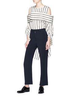 The Keiji Double placket stripe cold shoulder high-low top