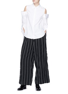 The Keiji Double placket cold shoulder high-low shirt