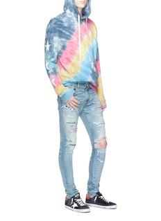 Amiri Art patch ripped skinny jeans