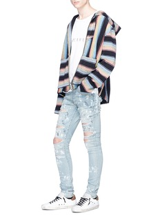 Amiri 'Super Destroy' paint splatter ripped jeans