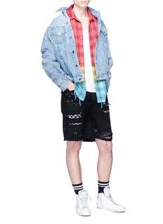 Amiri Art patch ripped denim shorts