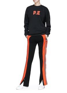 P.E Nation Flash Hit拉链裤脚口拼色条纹休闲裤
