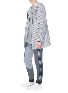 Adidas 'PLGN' geometric print oversized windbreaker jacket